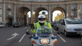 The baton visits Admiralty Arch where Inspector Derek Vickers holds it aloft