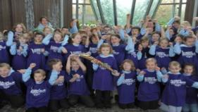 School children pose with the Queen's Baton 2010 Delhi in the dome at the National Botanic Garden of Wales in Carmarthen