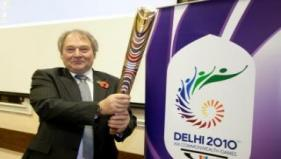Birmingham City Council Leader Mike Whitby holds the baton aloft at the reception