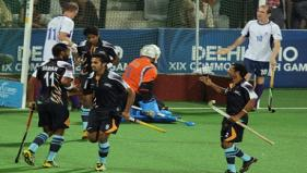 India's Sarwanjit Singh (11) and teammates celebrate their first goal against Scotland - PTI