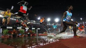 Athletes compete in the 3000m steeplechase event - PTI