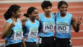 Indian athletes celebrate after winning bronze in the women's 4x100m relay during Delhi 2010 at the Jawaharlal Nehru Stadium. PT