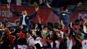 Members of the Indian contingent jubilate during the Closing Ceremony