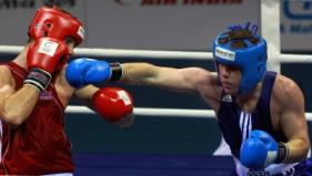 Patrick Gallagher (NIR) lands a punch on Callum Smith (ENG) during their lightweight 60kg boxing bout for Gold at Delhi 2010.PTI