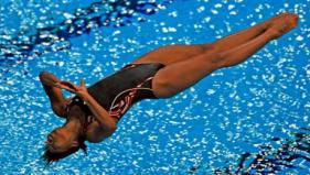 Canada's Abel Jennifer in action during the finals of the women's 1M springboard diving event at the Delhi 2010.- PTI