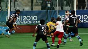 India's Sarvanjit Singh scores a goal against England during the 2nd semifinal match at the Commonwealth Games at Major Dhyancha