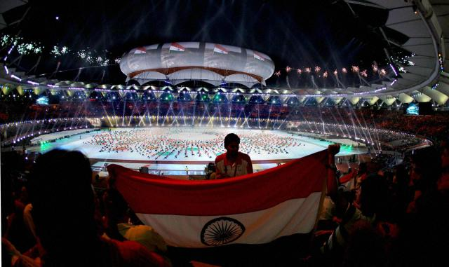 Spectators holding the Tri-Colour during the Closing Ceremony -PTI